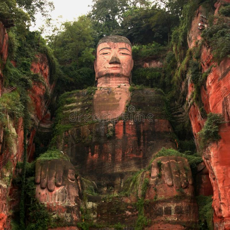 Leshan Giant Buddha carved into a mountain off the Min River in Sichuan. This UNESCO heritage site sits inside the Leshan Scenic Area and faces Mount Emei. On royalty free stock photography