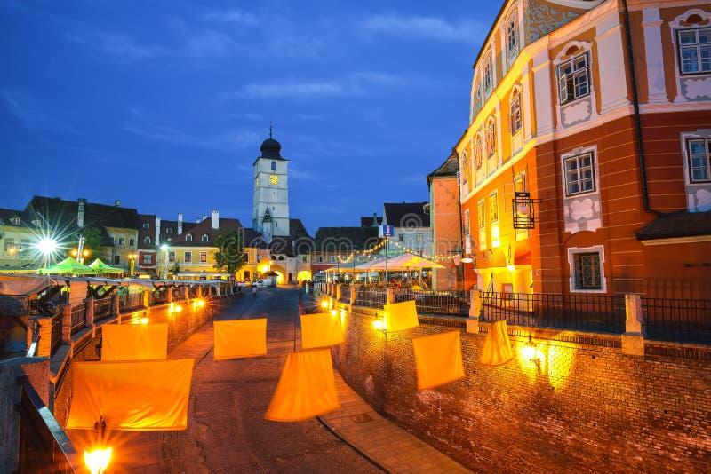 Lesser Square and Council Tower at twilight. Transylvania saxon city. Cityscape of Sibiu town, Transylvania, Romania, Europe royalty free stock photography