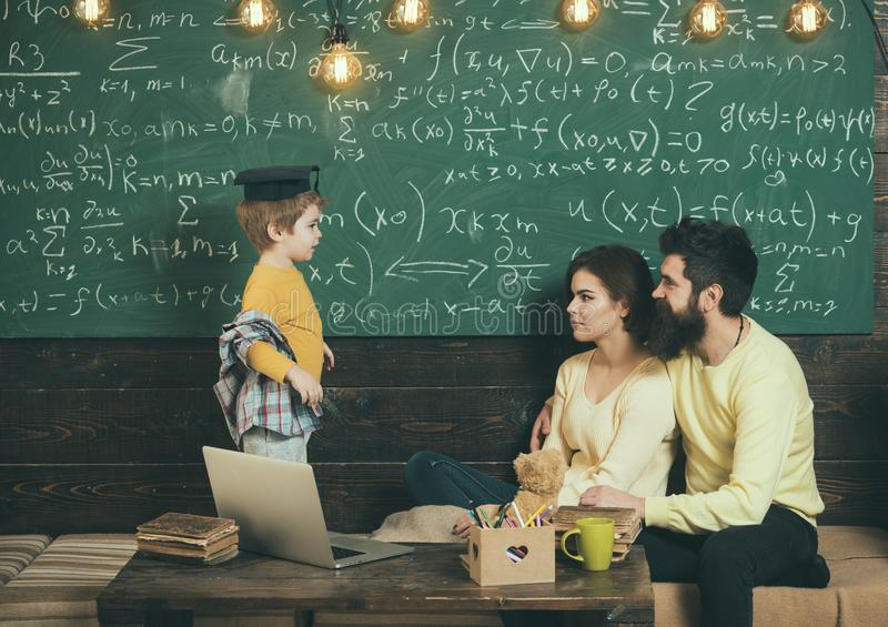 Lesson concept. Little boy answer lesson in classroom. First lesson at school. Lets repeat the previous lesson.  stock photo