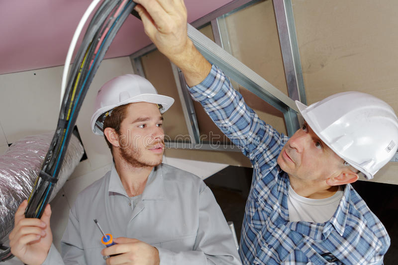 Lesson with electrician and apprentice royalty free stock photo