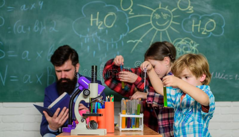 Lesson at school. Pupils in the chemistry class. back to school. Educational concept. happy children teacher. children stock photography