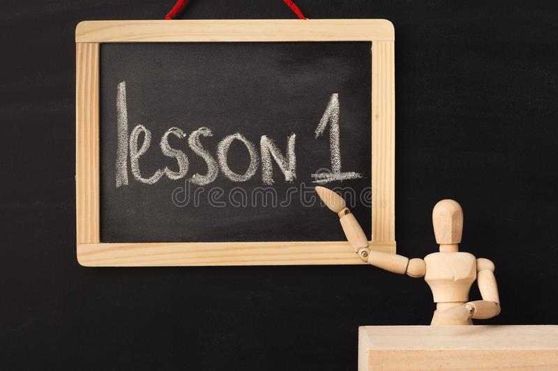 Lesson 1 written with chalk on blackboard. royalty free stock images
