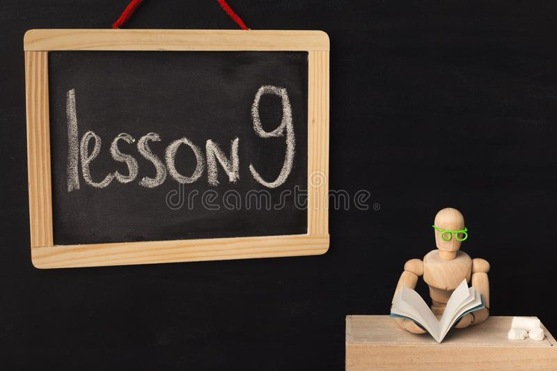 Lesson 9 written with chalk on blackboard. stock photo