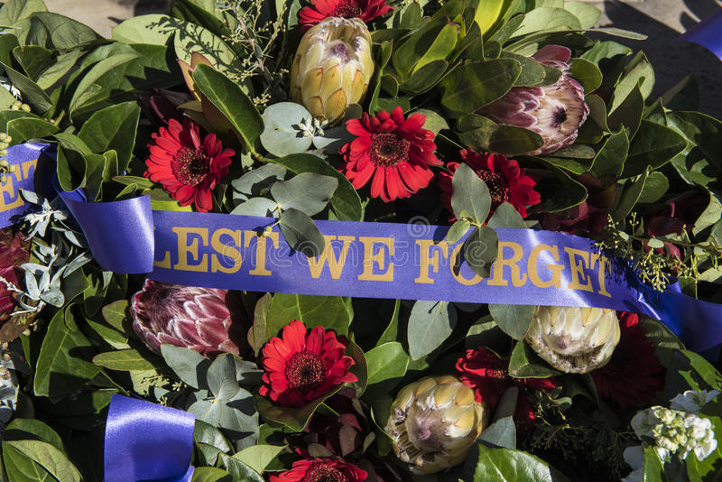Lest We Forget, Anzac Day memorial. Flowers adorn an ANZAC day memorial for the remembrance of fallen Australian and New Zealand military personnel during WW1 royalty free stock photo