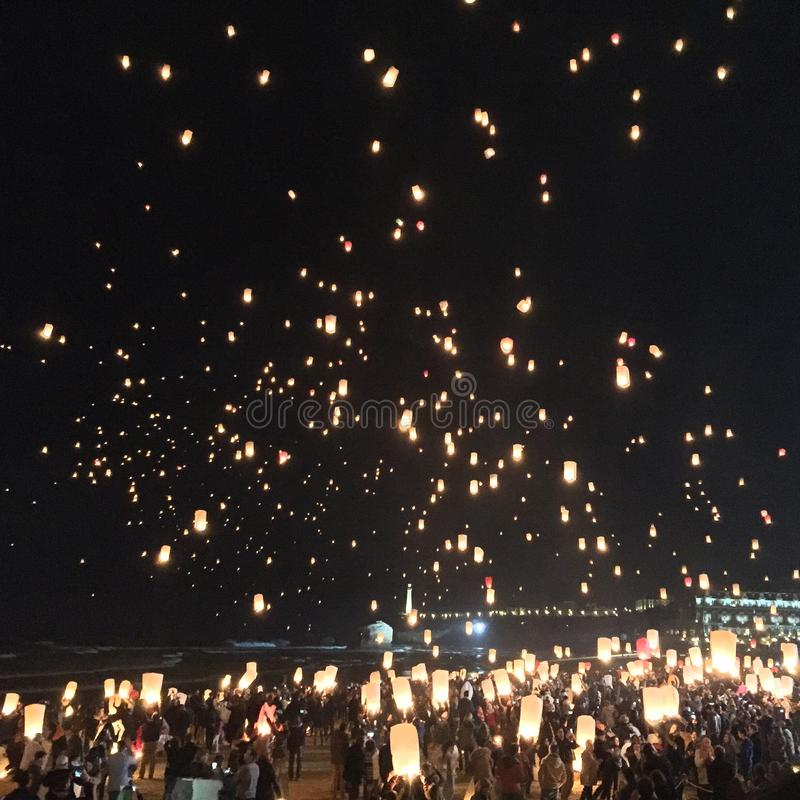 let go of sky lanterns in Biarritz stock photo