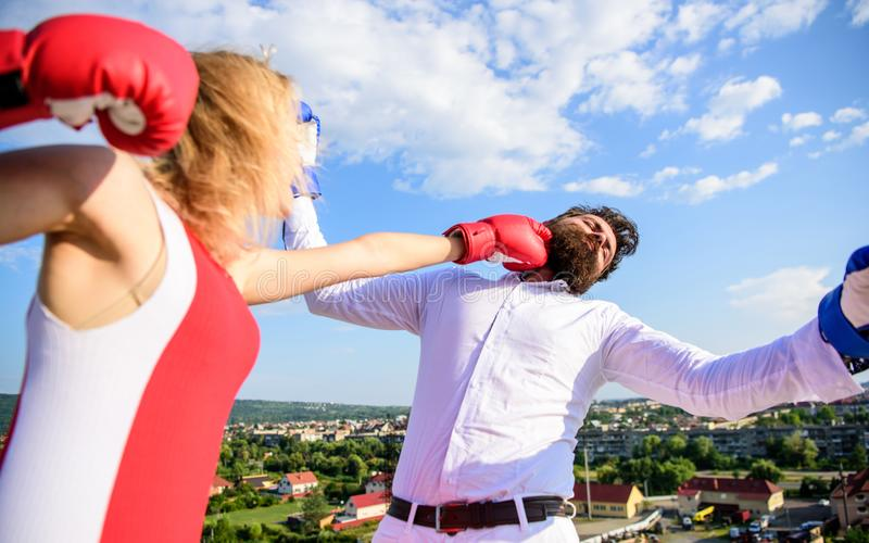 Let her win concept. Couple boxing gloves fight sky background. Girl confident strength power. Leadership family. Relations. Things guy can do to make women royalty free stock images