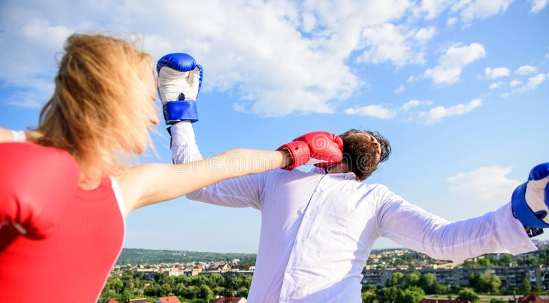 Let her win concept. Couple boxing gloves fight sky background. Leadership family relations. Things guy can do to make. Women happy. How to win her back royalty free stock images
