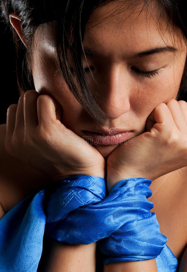 Let me go. Asian girl tied up against her will royalty free stock images