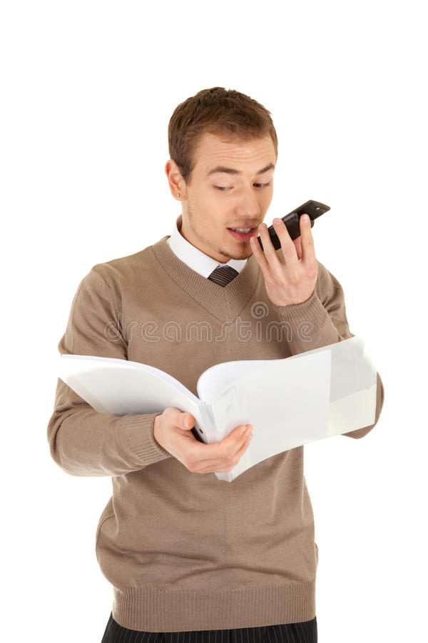 Let me repeat for you. Man with is looking in papers in a file and dictating in mobile phone . Isolated on white background royalty free stock image