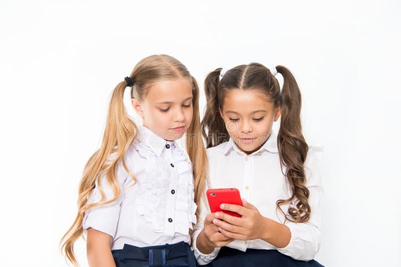 Let me show you something interesting. Educational application. Online entertainment concept. Schoolgirls cute pupils stock photos