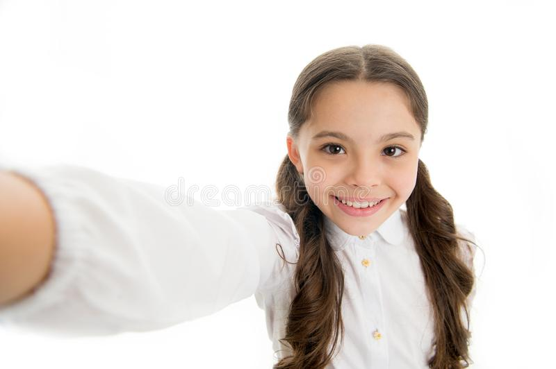 Let me take a selfie. Child girl school uniform clothes holds smartphone takes photo. Child school uniform kid happy royalty free stock image