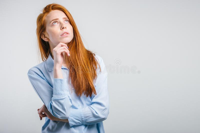 Let me think. female keeping hand on her chin stock images
