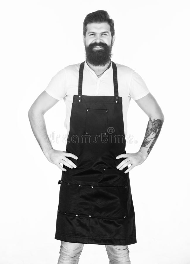 Let my happy smile warm your hearts. Happy man wearing barber or cooking apron. Bearded man happy smiling in bib apron. Brutal hipster with happy smile on stock images