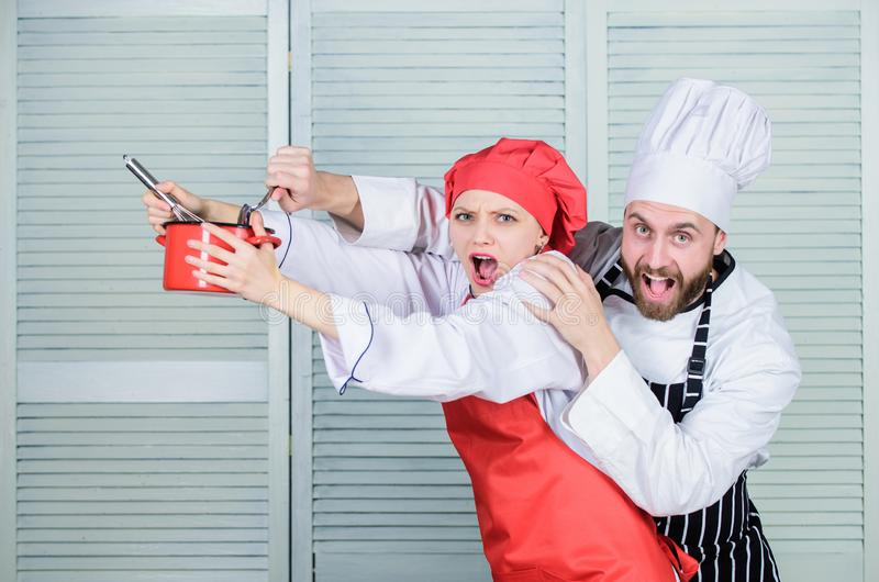 Let my try taste. Couple having fun while whipping cream. Cooking healthy meal. Cooking together is more fun. Woman and. Bearded men chef cooking together stock photography