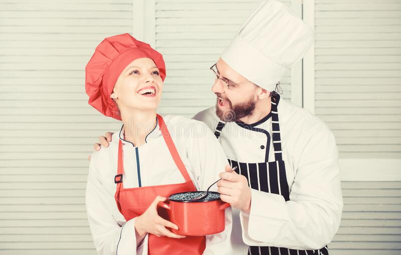 Let my try taste. Couple having fun while whipping cream. Woman and bearded man chef cooking together. Cooking healthy. Let my try taste. Couple having fun while royalty free stock image