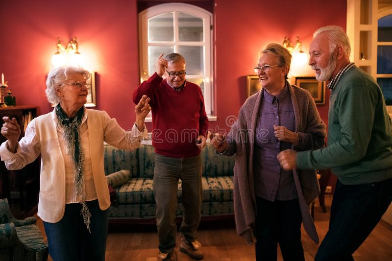 Let`s dance, group of senior people dancing and having fun royalty free stock photo