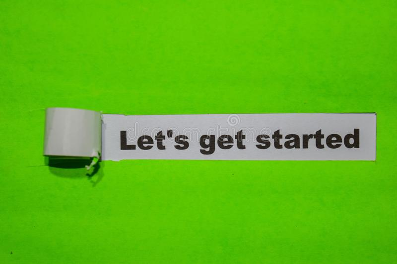Let`s Get Started, Inspiration and business concept on green torn paper stock photography
