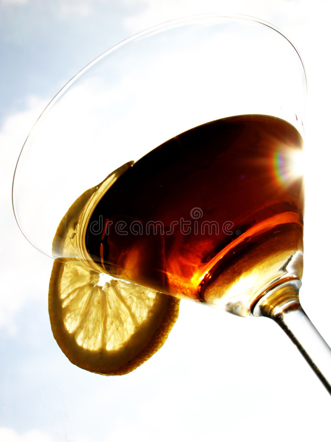 Let's party! 5. Martini close-up, glass and lemon, detailed stock photo