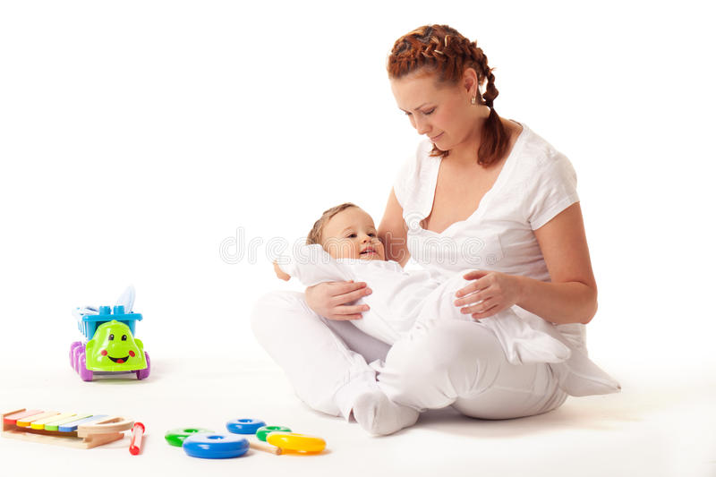 Let's play. Big boy still loves mother's knees royalty free stock photos