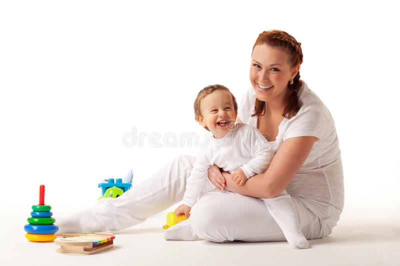 Let's play. Happy mother playing with son royalty free stock images
