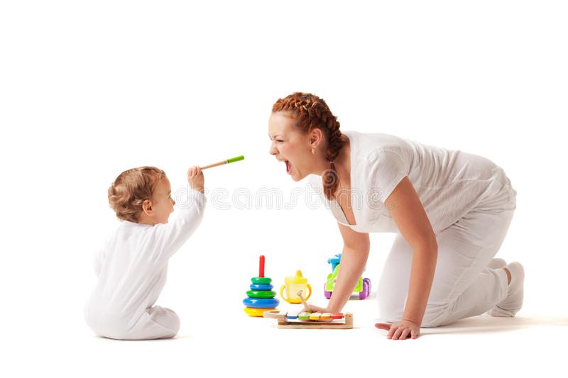 Let's play. Mother is showing son how to play xylophone stock images