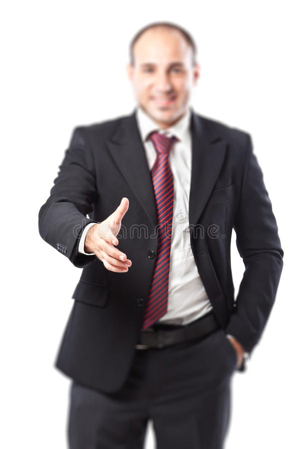 Let's shake. A well dressed businessman preparing for shake hands (focus on the hand royalty free stock images