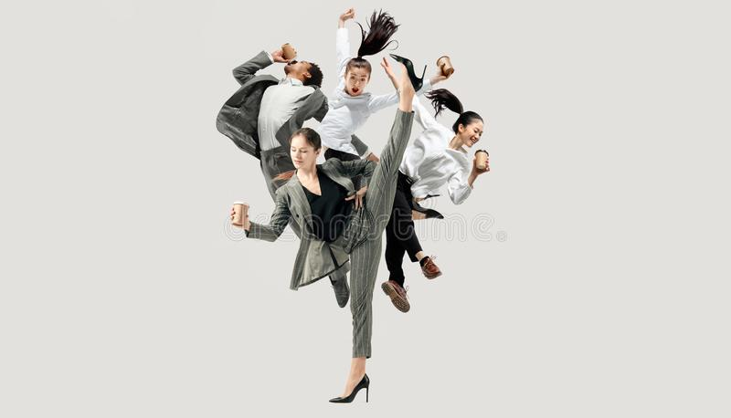 Office workers jumping isolated on studio background royalty free stock images
