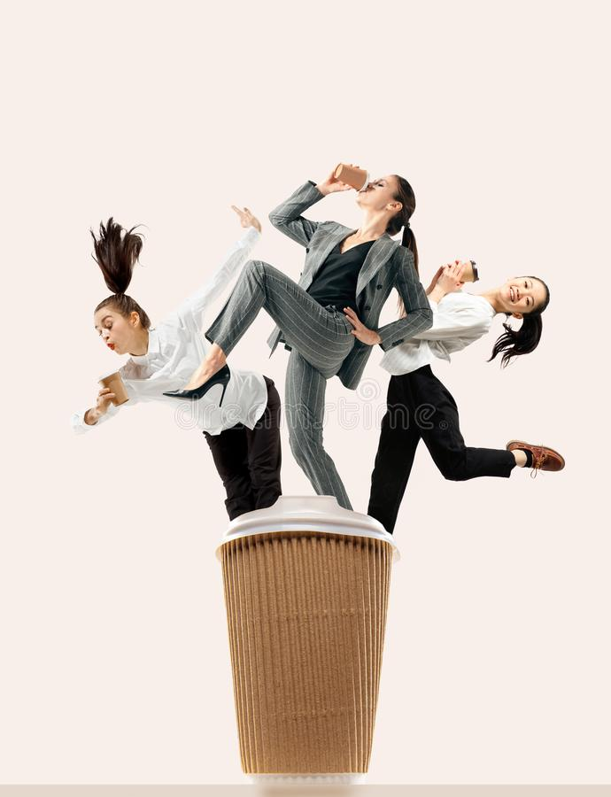 Office workers jumping isolated on studio background stock image