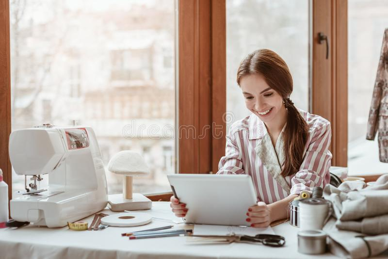 Let`s start to create. Stylist working with laptop in design studio. stock photography