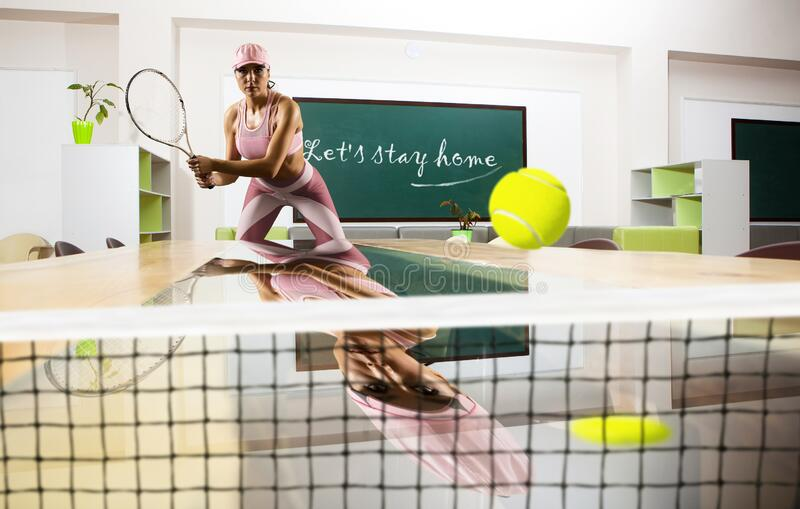Let`s stay home. Quarantine. Female tennis player. Sport concept royalty free stock images
