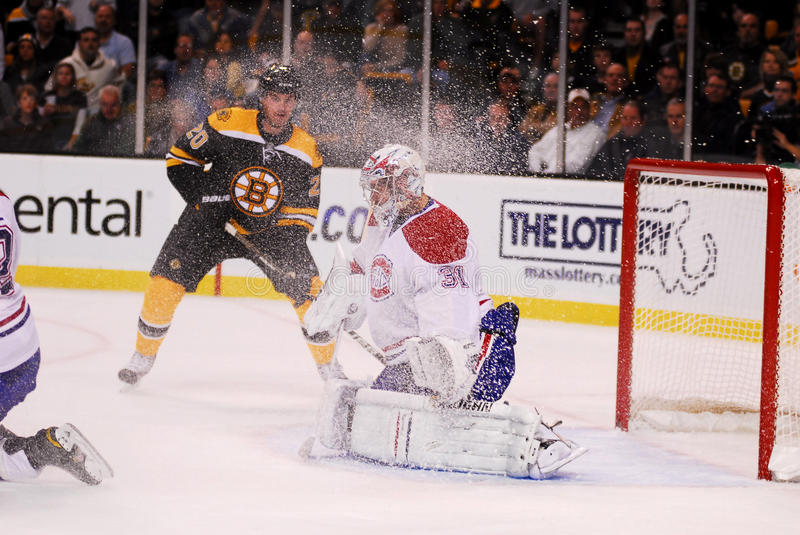 Let it Snow!. Canadiens goaltender Carey Price gets snowed by a Boston Bruins forward stock images