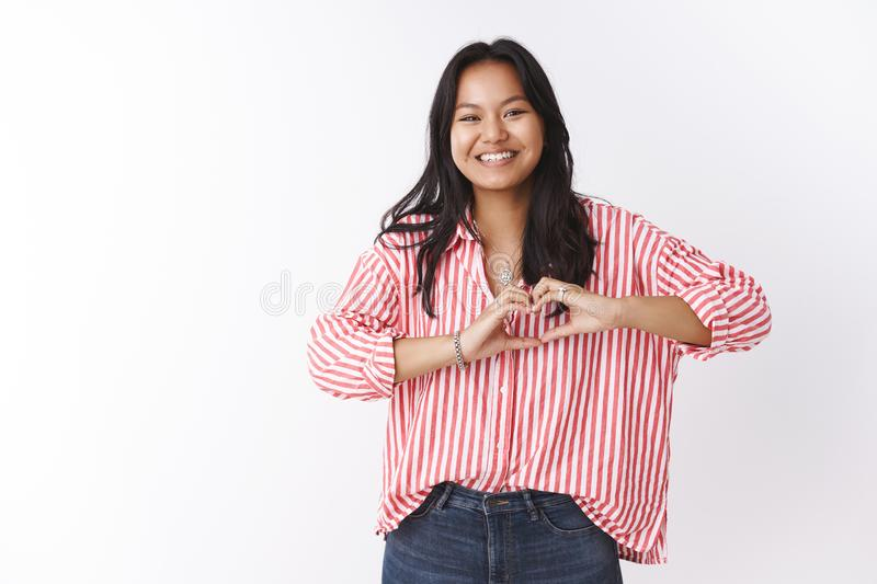 Let there be love. Portrait of charming upbeat and confident young asian woman confessing in sympathy and feelings royalty free stock images