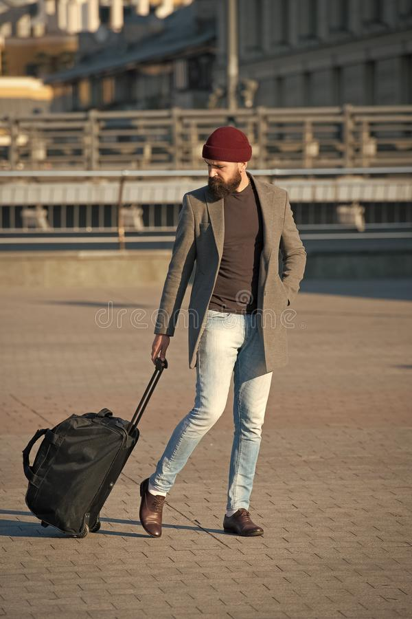 Let travel begin. Traveler with suitcase arrive to airport railway station. Hipster ready enjoy travel. Carry travel bag. Business trip. Man bearded hipster royalty free stock photos
