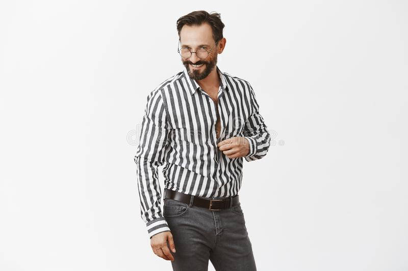 Let us continue conversation in bedroom honey. Portrait of flirty handsome adult man with beard, unbuttoning shirt and stock photo