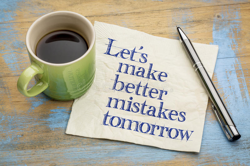 Let us make better mistakes tomorrow -napkin concept. Let's make better mistakes tomorrow - handwriting on a napkin with a cup of coffee royalty free stock photo