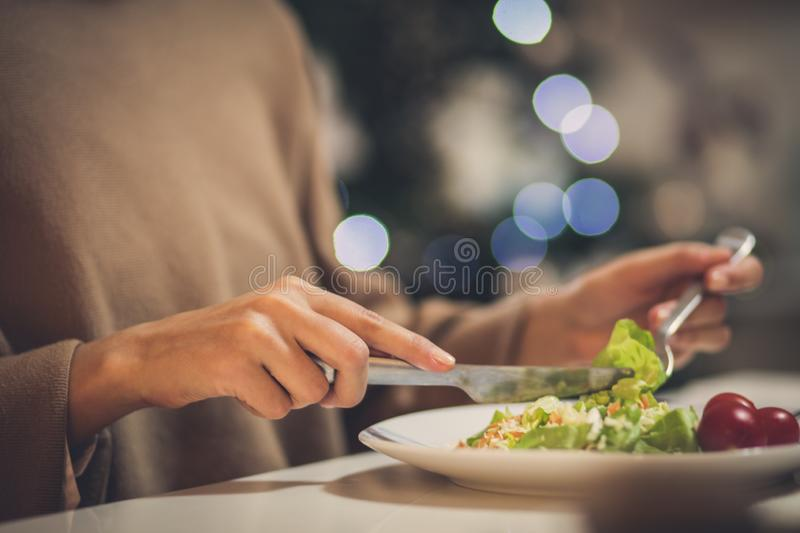 Let your body be healthy in the coming years. Woman eating at home. Close up royalty free stock photos