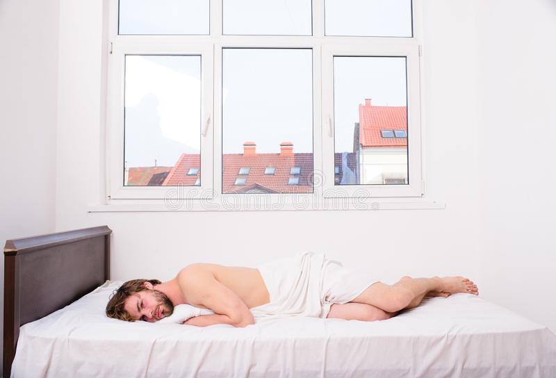 Let your body feel comfortable. Guy nude macho lay white bedclothes. Pleasant relax concept. Make sure mattress. Comfortable and supportive. Man tired exhausted stock photos