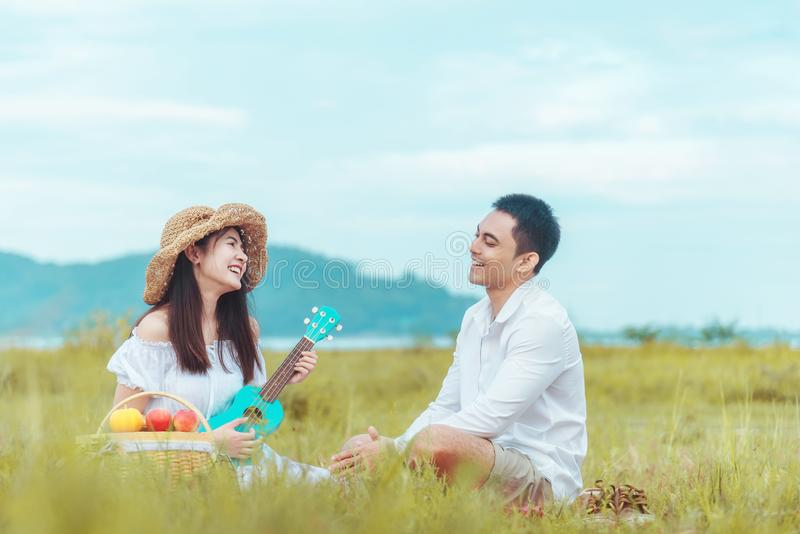Let your life be sweet like this cake. Couple in a meadow with a birthday cake.  stock photo