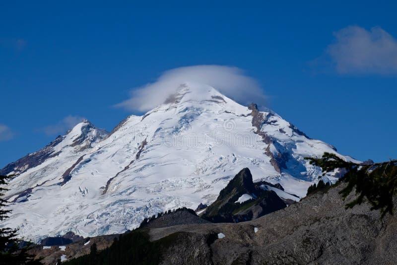 Leticular clouds over mountain top. stock photos