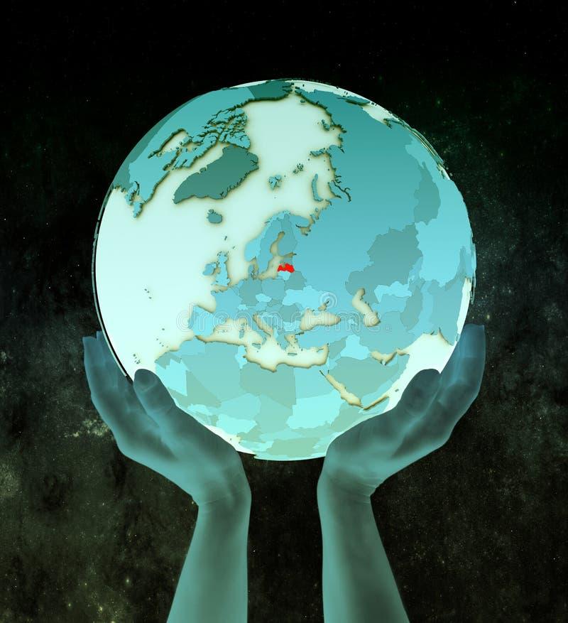 Letland op blauwe bol in handen stock illustratie