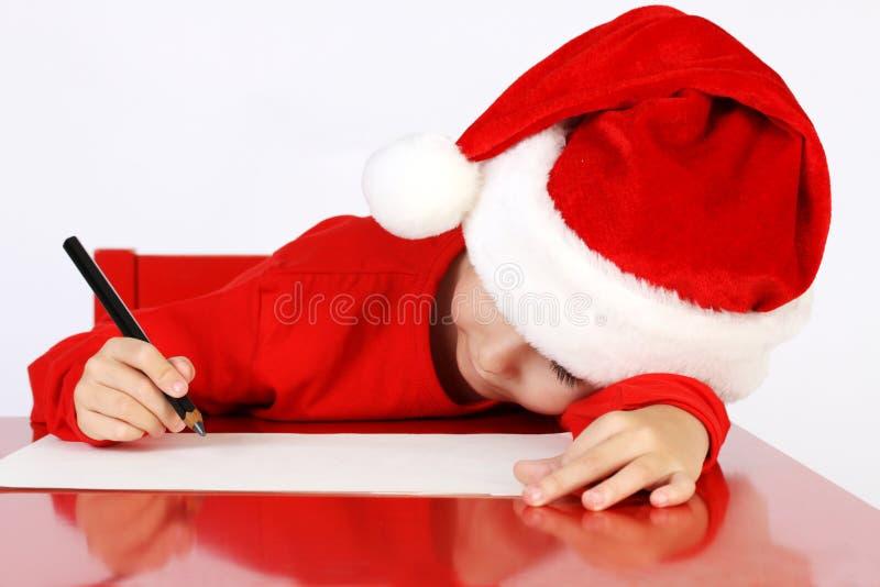 Letra da escrita da criança do ajudante do Natal a Santa Cla foto de stock