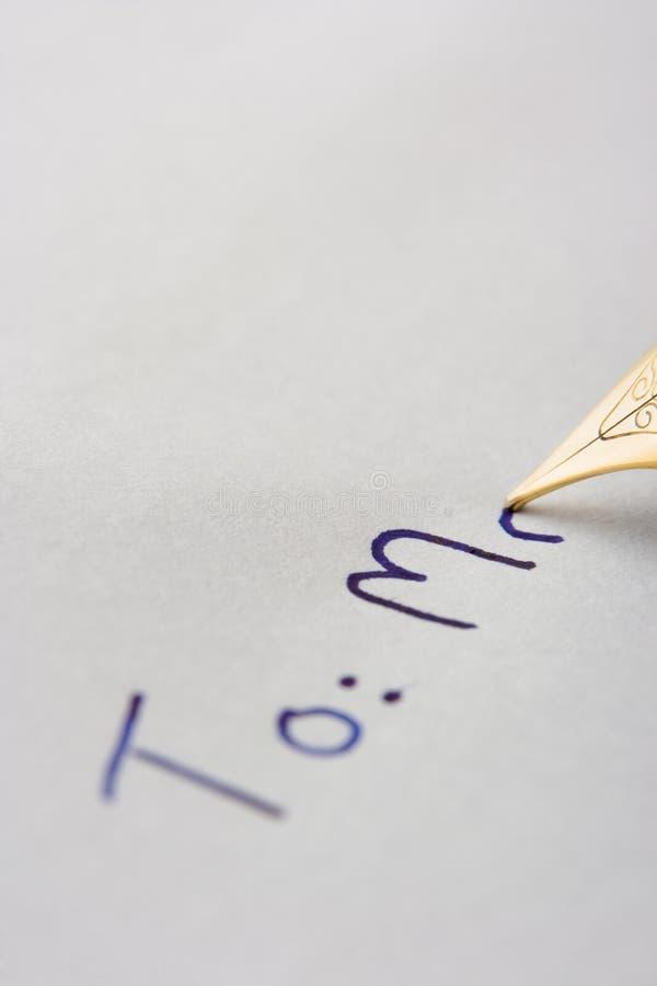 Letra da escrita da pena a um Sr. fotografia de stock