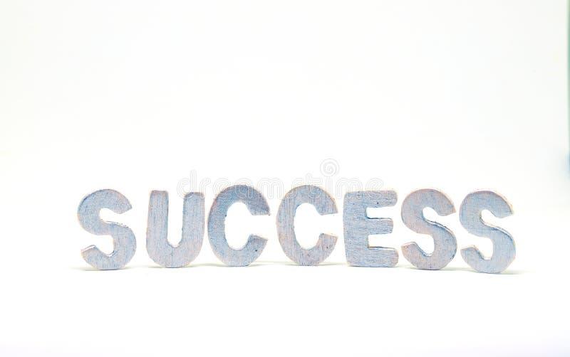 Letra de plata de la palabra del éxito en el fondo blanco Letra de madera permanente Palabra positiva para el proceso del negocio fotos de archivo libres de regalías