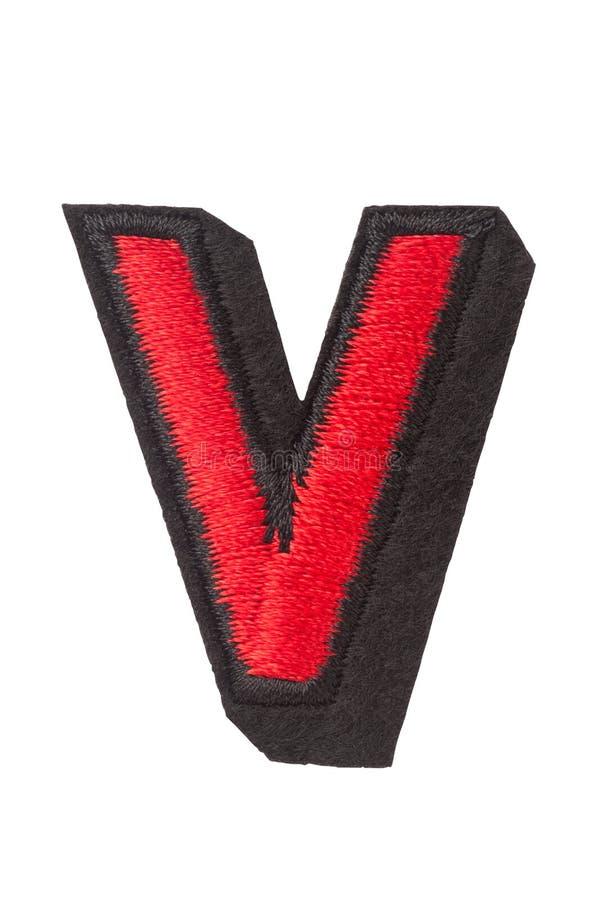 letra V del capitol de cosido con el hilo imagen de archivo