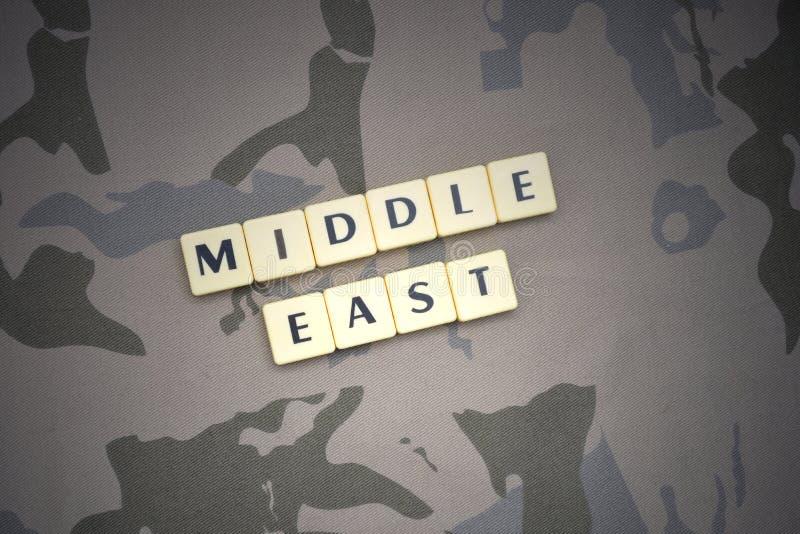 Letras con el texto Oriente Medio en el fondo de color caqui Concepto militar fotos de archivo libres de regalías