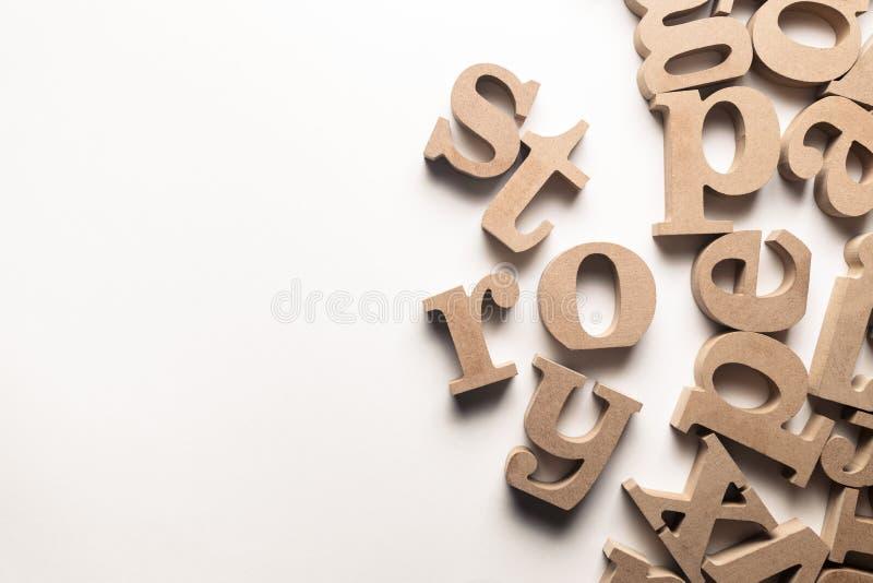 Letras da madeira da história imagens de stock royalty free