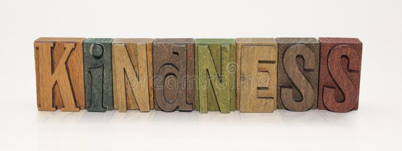 Letras de bloco da palavra da bondade - fundo branco fotos de stock