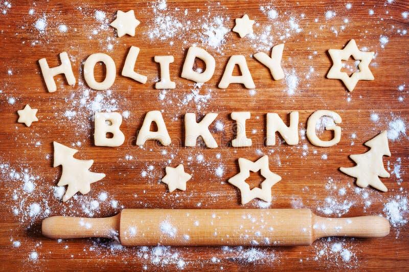 Letras de la pasta y de las galletas de la Navidad en la tabla fotografía de archivo