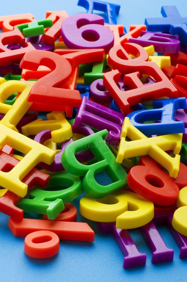 Letras e números no fim do azul acima foto de stock royalty free