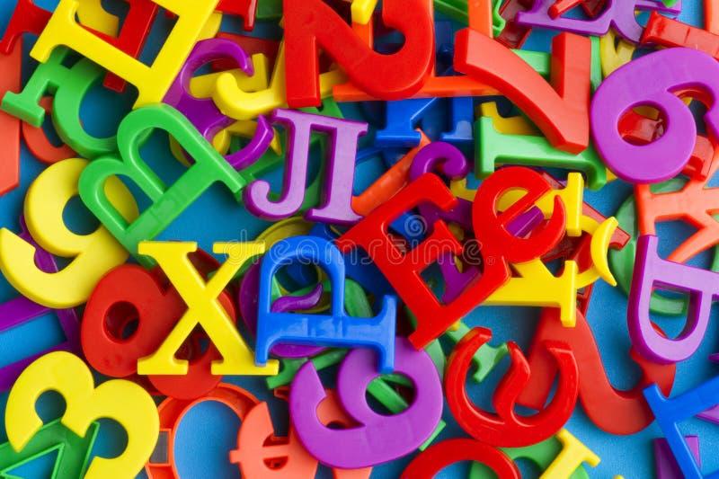 Letras e números no macro azul fotografia de stock royalty free